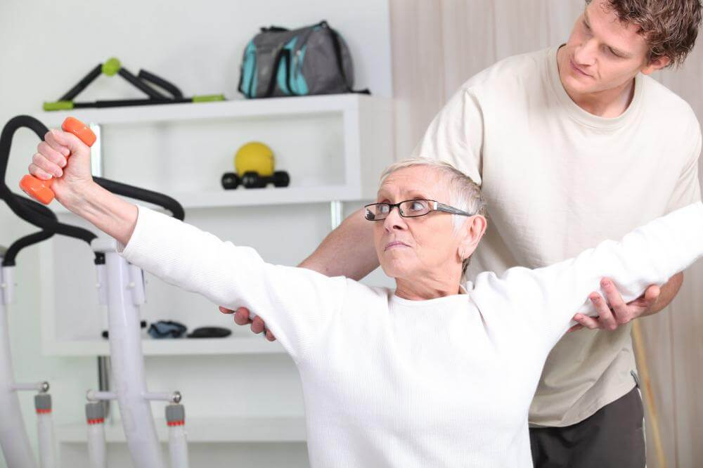 http://streaming.yayimages.com/images/photographer/phovoir/223f5680f475a2668b0d4852edab19b9/a-trainer-helping-a-senior-woman-doing-fitness.jpg