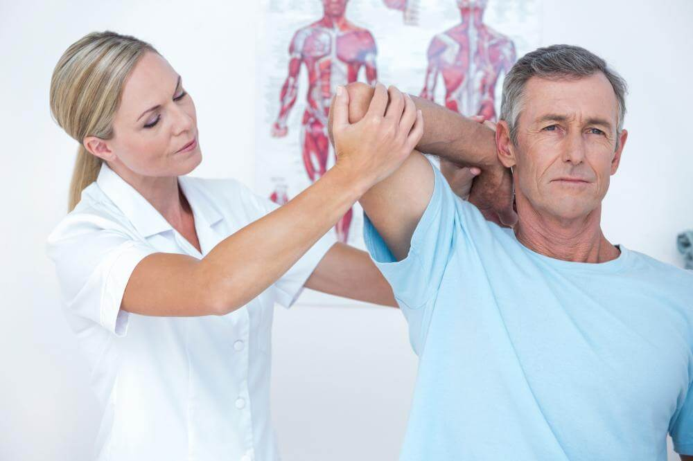 doctor-stretching-a-man-arm.jpg