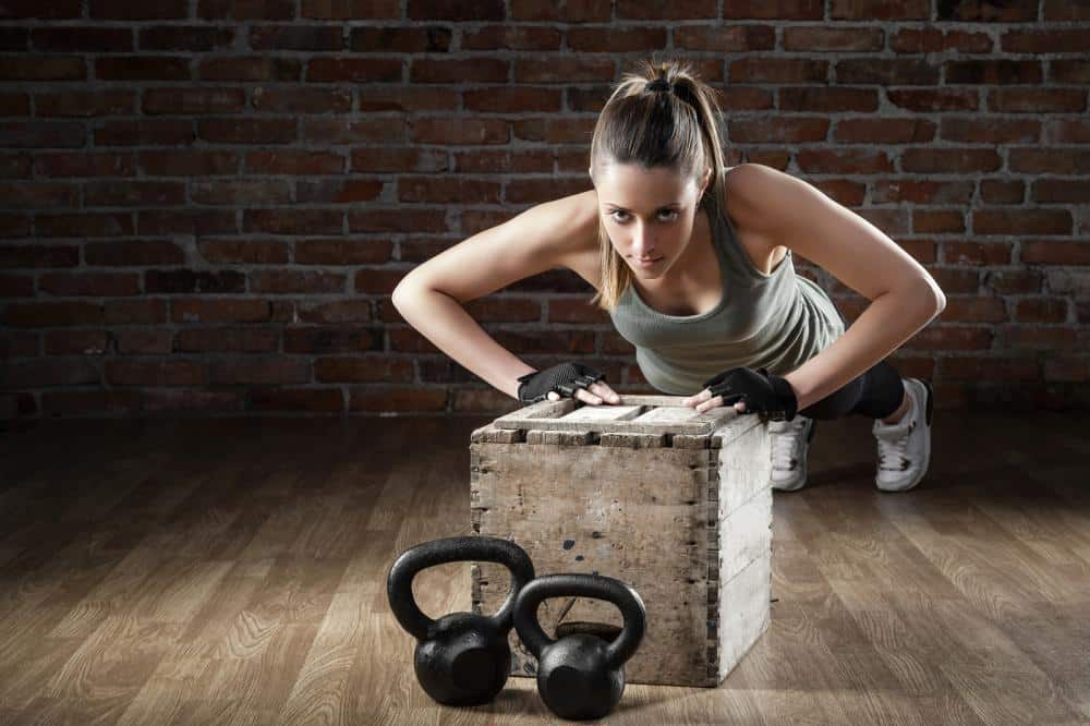 http://streaming.yayimages.com/images/photographer/alessandroguerriero/9e190ebcdbca6571c6dc0fbe48ac8d35/young-fit-woman-pushing-up-on-brick-background.jpg
