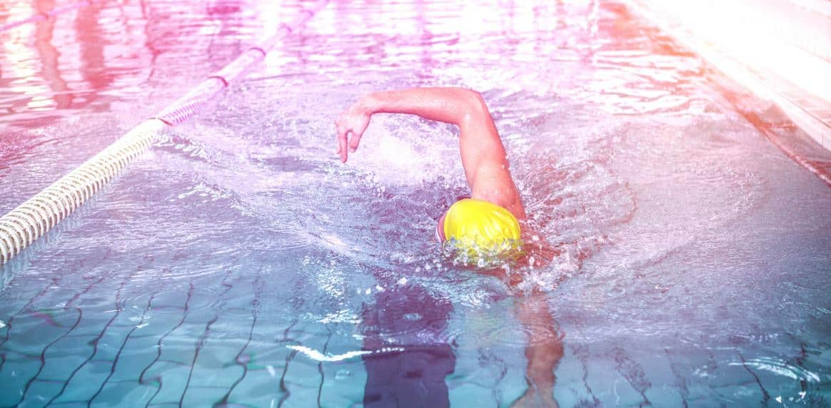http://streaming.yayimages.com/images/photographer/wavebreakmedia/a5fbb9649ee0786186d981a5f5362487/fit-man-swimming-with-swimming-hat.jpg